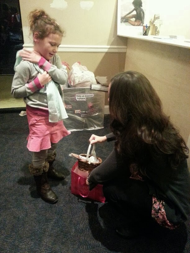 Ellie gives to children